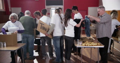 An enthusiastic group of charity volunteers Stock Footage