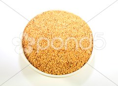 A bowl of golden linseed Stock Photos