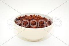 Sultanas in a bowl Stock Photos