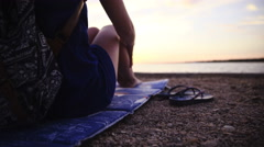 Woman sit on beach at sunset time elevated shot 4K Stock Footage