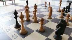 Large chess figures on the floor Stock Footage