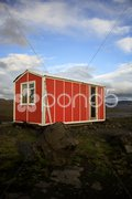 Orange emergency hut Stock Photos