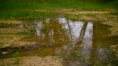 Mountian Biker Splashing Through Puddle Of Mud Water Stock Footage
