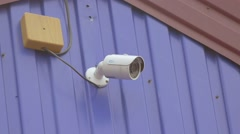 On a wall video surveillance camera slow motion Stock Footage