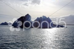 Silhouetted icebergs Stock Photos