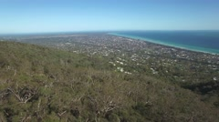 Forward flight from Seawinds Gardens lookout towards the water on Mornington Stock Footage