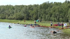 Athletes kayaking and canoeing are trained at the shore. Stock Footage