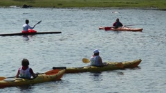 Near the shore floating people in canoes and kayaks. Stock Footage