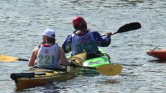 Athletes train in the water near the shore - kayaks and canoes. Stock Footage