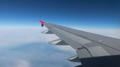 Wing of airplane flying in sky Stock Footage