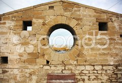 View through the harbour wall Stock Photos