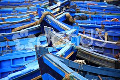 Blue fishing boats Stock Photos