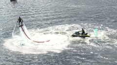 Holiday Murmansk mile. Athlete on the flyboard flying over cold water. Stock Footage