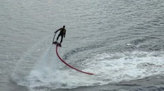 Holiday Murmansk mile. Athlete on the flyboard dives into the water. Stock Footage