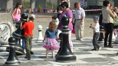 Holiday Murmansk mile. Children play in the huge chess. Stock Footage