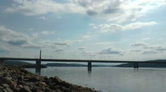 He shore of the Bay and the bridge on the background moving cloud, timelapse. Stock Footage
