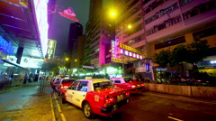 RED TAXIS WAITING FARE CAUSEWAY BAY HONG KONG Stock Footage