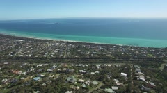 Backward flight away from Port Phillip bay on Mornington Peninsula in summer Stock Footage