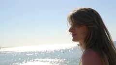 Young woman goes with pareo on the sea. HD Stock Footage