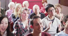 Cheerful audience members at a  public meeting  applaud the speaker Stock Footage