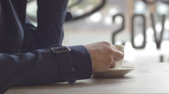 Static shot of girl's hand taking a coffee from a table in cafe Stock Footage