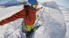 Snowboarding standing on a hill top Stock Footage