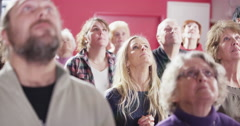 Informal contemporary church group of mixed age and race praying Stock Footage
