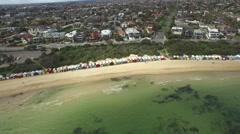 Flight towards the Brighton Beach bathing huts descending with camera tilt. Stock Footage