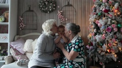 Grandmother and Great-Grandmother of a Child Playing With the Christmas Tree Stock Footage