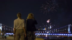 People watching and making photoes of fireworks over bridge. 4K video Stock Footage