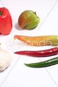 Scharfer Hintergrund Chilis Stock Photos