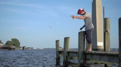 CRAB FISHERMAN PULLING THE LINE PIER SETTING CHESAPEAKE BAY SLOW MOTION Stock Footage