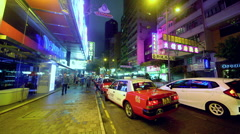 LINE OF RED TAXIS CAUSEWAY BAY HONG KONG CHINA Stock Footage