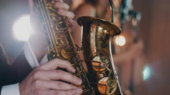 Saxophonist play on golden saxophone. Jazz artist. Professional musician Stock Footage