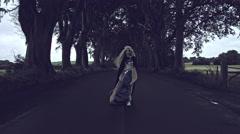 4k Fantasy Shot in Dark Hedges, Queen Walking to Camera Stock Footage