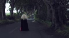 4k Fantasy Shot in Dark Hedges, Queen Walking Away (focus changing) Stock Footage
