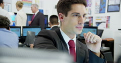 Portrait of a young and ambitious stock market trader Stock Footage