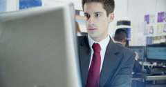 Young and ambitious stock market trader is doing a deal Stock Footage