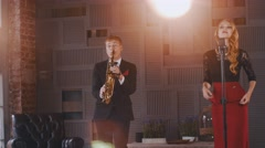 Jazz duet perform on stage. Saxophonist and vocalist. Retro style. Artists Stock Footage