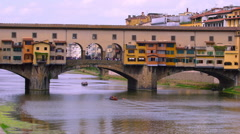 PONTE VECCHIO ROWING BOAT FIRENZE TUSCANT ITALY Stock Footage