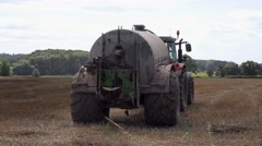 Farm tractor spreading manure Stock Footage