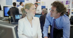 Male and female financial traders are working Stock Footage