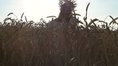 Beautiful girls whirling, dancing and playing in the middle of a wheat field Stock Footage