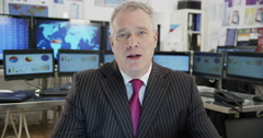 A mature male businessman is engaged in a video call Stock Footage
