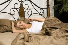 Young attractive real blond woman in bed sexual pose, lifestyle people concept Stock Photos