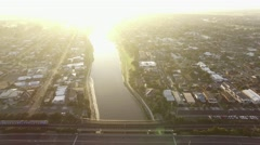 Slow descent in front of Nepean Highway bridge over Patterson river with cars Stock Footage