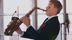 Saxophonist play on golden saxophone. Live performance. Jazz artist. Musician Stock Footage