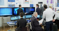 A diverse team of financial traders are hard at work Stock Footage