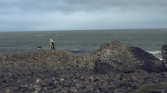 4k Fantasy Shot on Giant's Causeway of a Queen Standing on Stones Stock Footage