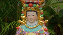 Sculpted and Painted Religious Image at a Buddhist Temple in Macau Stock Footage